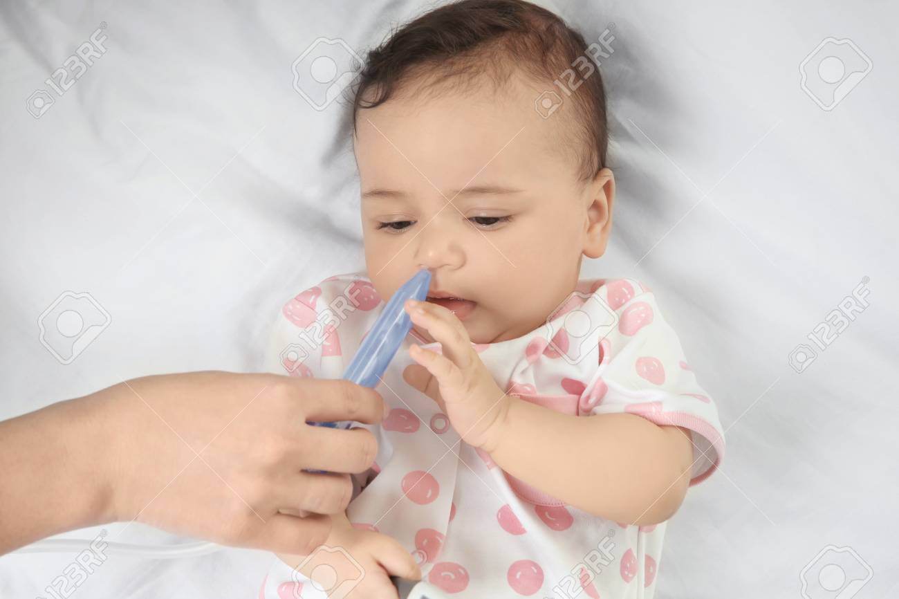Popular Little Baby Lying On Bed At Care Mor Using Nasal Aspirator Little Baby Lying On Bed Baby Nasal Aspirator Nz Baby Nasal Aspirator Walgreens Mor Using Nasal Aspirator baby Baby Nasal Aspirator