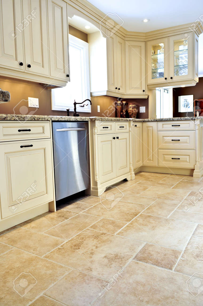 3930814 Ceramic tile floor in a modern luxury kitchen Stock Photo