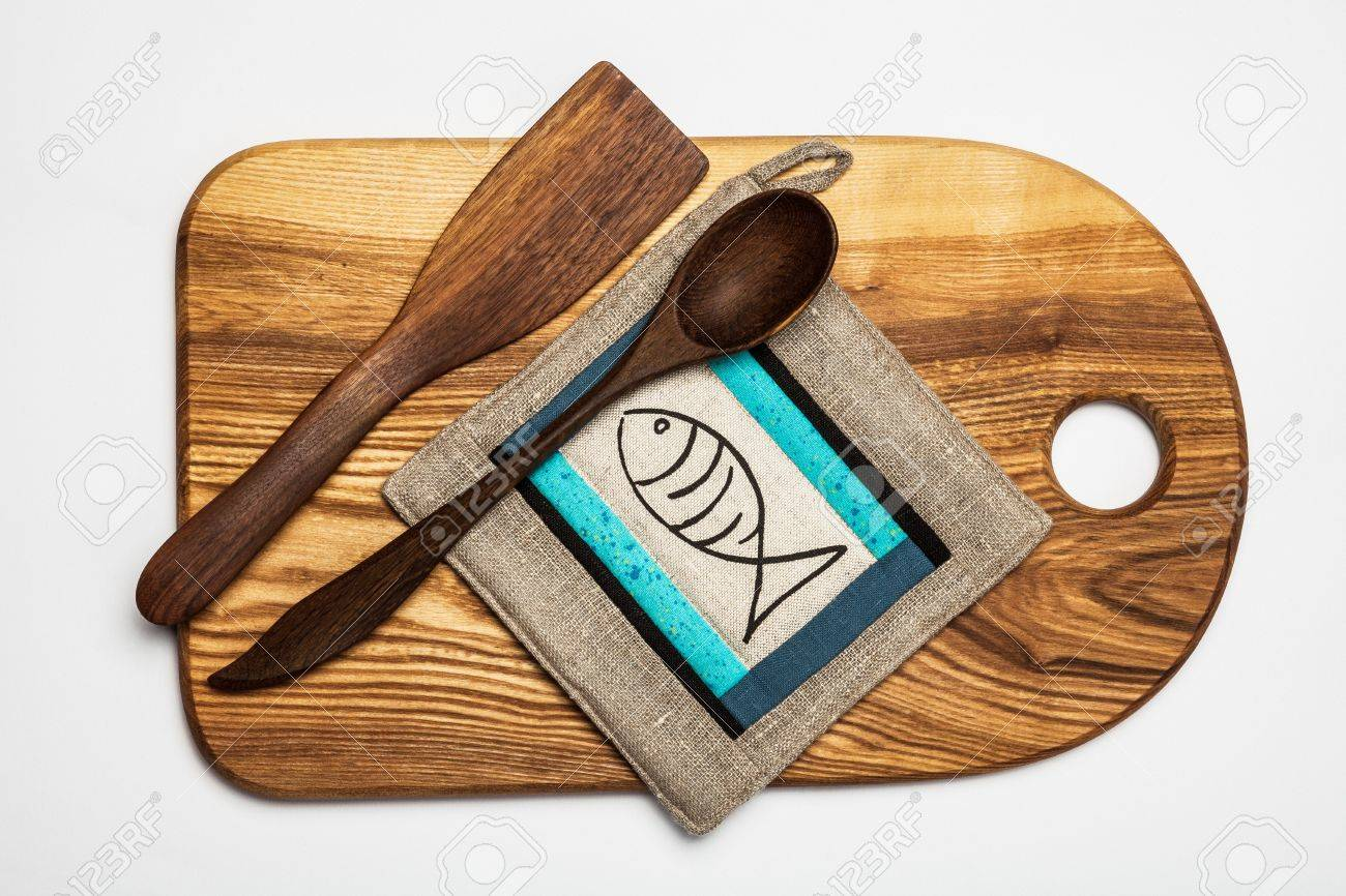 30420261 Kitchen equipment wooden cutting table tools and patchwork potholder Stock Photo