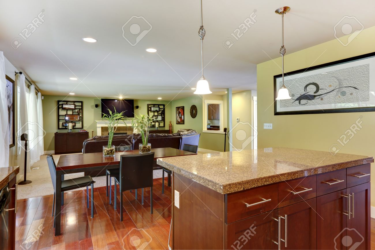31078533 Kitchen island with granite top and classic dining table with chairs Stock Photo