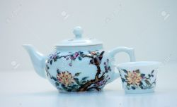 Examplary Stock Photo Tiny Teapot Cup Is A Design Painted On This Is Set Against A Tiny Teapot Cup Is A Design Painted On