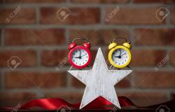 Prissy Ribbon On Star Shaped Wall Clocks Ribbon On Brickwall Background Photo Star Shaped Alarm Clocks Photo Star Shaped Alarm Clocks