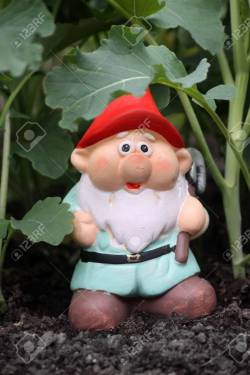 Fanciful A Small Colorfully Decorated Bearded Garden Gnome A Red Hat Andpale Blue Tunic A Small Colorfully Decorated Bearded Garden Gnome Stock