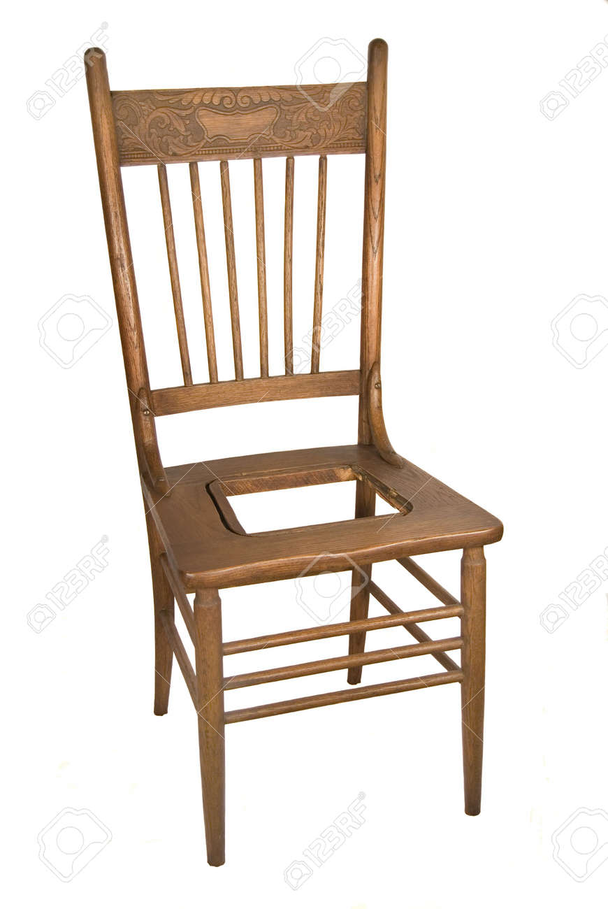 880138 Antique oak carved back kitchen chair with rush missing from seat Stock Photo