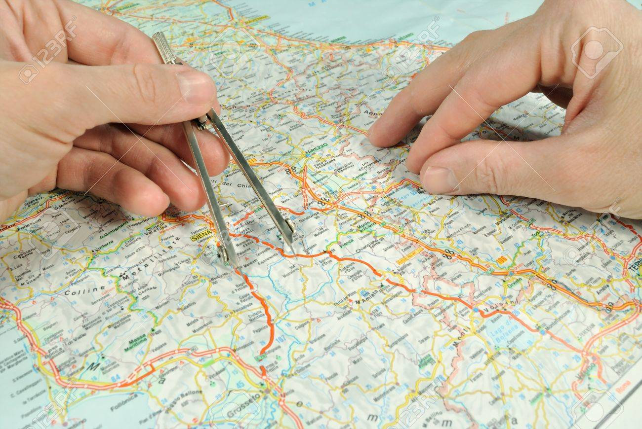 The Measuring Of Distance By Dividers On The Map  Stock Photo     Stock Photo   The measuring of distance by dividers on the map