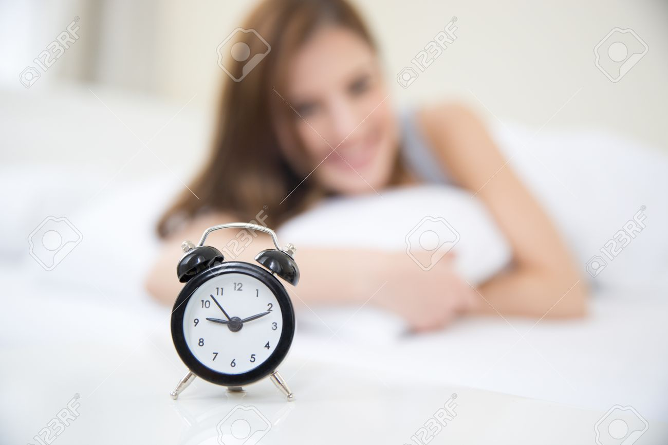 Joyous Looking On Alarm Focus Onclock Happy Woman Waking Up Seeing Your Birthday Morning Morning Looking On Alarm Clock Looking At Clock At 1111 Looking At Clock Happy Woman Waking Up furniture Looking At Clock