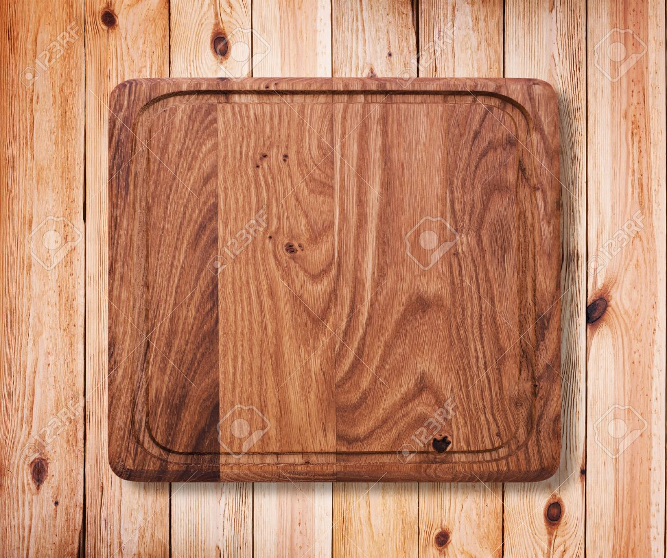 31084248 Wood texture Wooden kitchen cutting board close up Empty wooden table on white background for produc Stock Photo