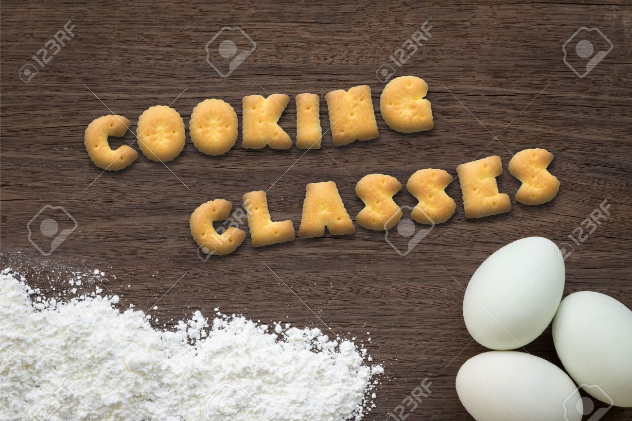 41906236 Top view of letter text collage made of cookies biscuits Word COOKING CLASSES putting on baking back Stock Photo