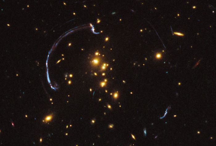 Extremely-Distant-Galaxy-Imaged-via-Gravitational-Lensing-2