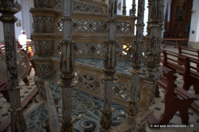 One of two wrought iron stairs in the church