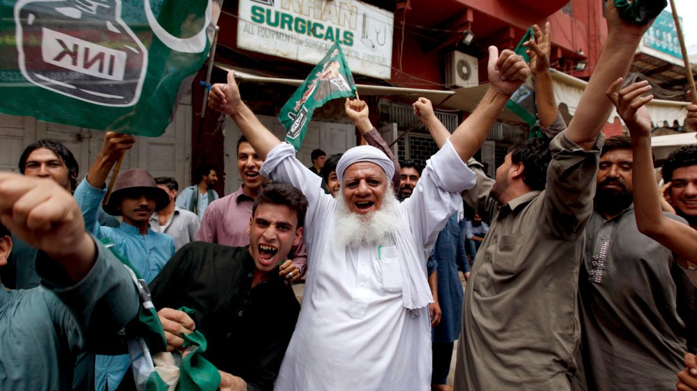 Opposition party supporters celebrate following the announcement of the Supreme Court's disqualification of Prime Minister Nawaz Sharif in Rawalpindi, Pakistan. (AAP)