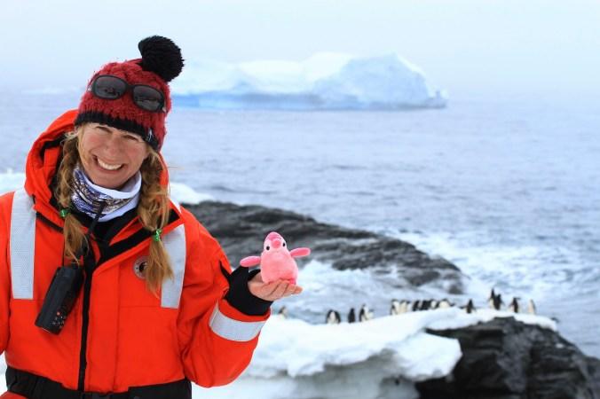 Brooke and her penguin in Antarctica