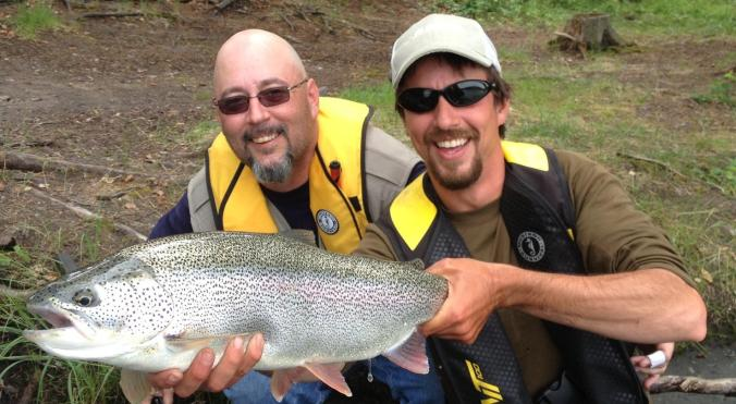 Phil and a client thrilled to with his catch of a big resident rainbow