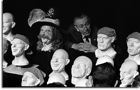 Walt Disney with unfinished heads from Pirates of the Caribbean