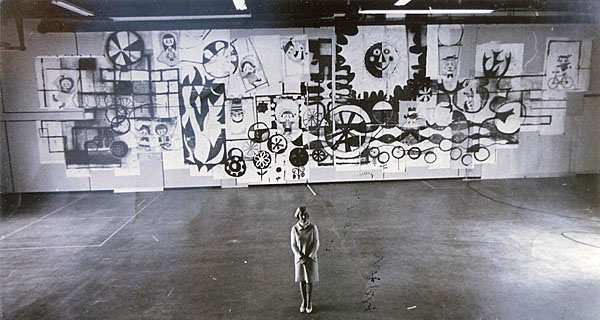 Mary Blair surveys the mural she created for Disneyland's 1967 Tomorrowland remodel