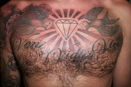 cool chest tattoo deisgn for man