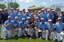 Boys' baseball poses with the regional championship trophy. Winning the regional was the team's goal, and they accomplished this on May 30 by beating Glenbrook North 3-0.
