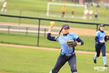 Junior Lauren Caldrone throws the ball to first in the Knights game versus Palatine on May 3. Caldrone moved from third base to shortstop for a portion of the season when Junior Alyssa Cacini was sidelined with an ankle injury.