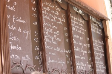 A menu at a Lourmarin Village restaurant