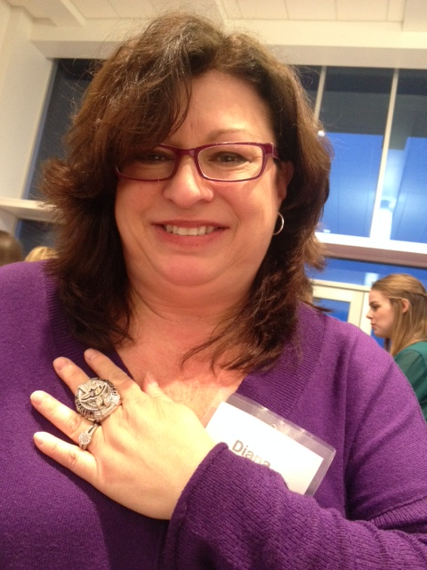 Diana from Elizabethtown College tries on Super Bowl Ring