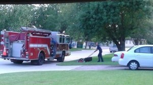 You'll Be Moved To Tears When You Learn Why This Firefighter Is Mowing The Lawn