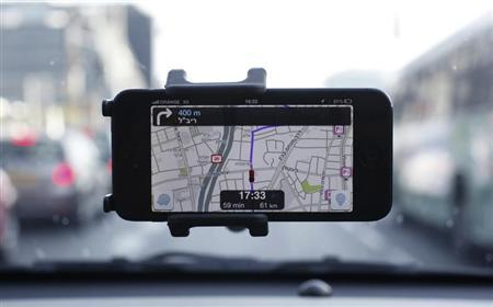 Waze, an Israeli mobile satellite navigation application, is seen on a smartphone in this photo illustration taken in Tel Aviv