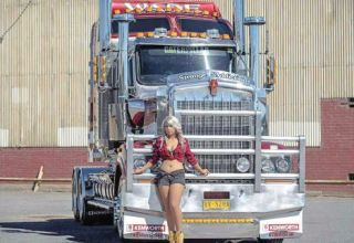 *** MANDATORY BYLINE *** PIC BY A&C photography / Caters News (PICTURED: Blayze, 26, from Australia, in front of a truck in March 2016.) - When you think of the average Aussie truckie, Blayze Williams is not what comes to mind.  With her long blonde locks and petite figure, the 26-year-old blonde beauty is an unusual sight on the drivers seat of a semi-trailer.  But the part-time glamour model has been in making inroads in the industry ever since she serendipitously found herself behind the big wheel eight years ago. SEE CATERS COPY