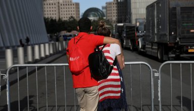 A couple pauses as they embrace on a street outside the National 9/11 Memorial and Museum during ceremonies marking the 16th anniversary of the September 11, 2001 attacks in New York, U.S., September 11, 2017.  REUTERS/Shannon Stapleton