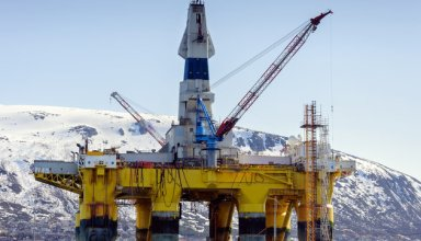 A floating oil rig in harbour in northern norway in winter