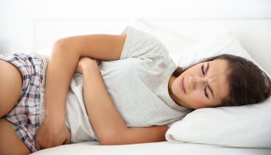 bigstock-Young-woman-with-stomach-ache--168310289