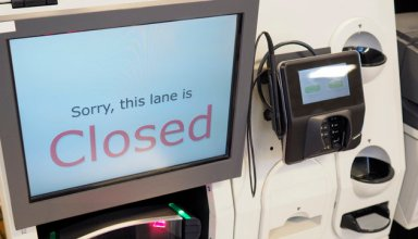 A supermarket self-checkout lane machine till with a closed sign displayed on the screen. Also known as a SACAT.