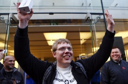 Ralf Marth from Munich celebrates being the first customer at an Apple store receiving an iPhone 5 in Munich.