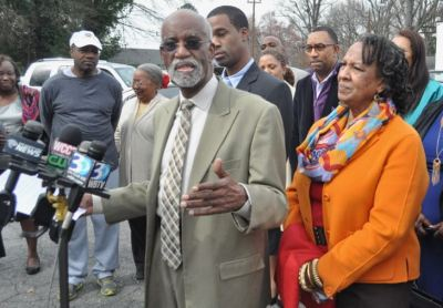 Charlotte Attorney James Ferguson, center, talks with reporters about the uncertain fate of the historic Excelsior Club, an icon of Charlotte's black community since 1944. (Photo: Glenn H. Burkins for Qcitymetro.com)