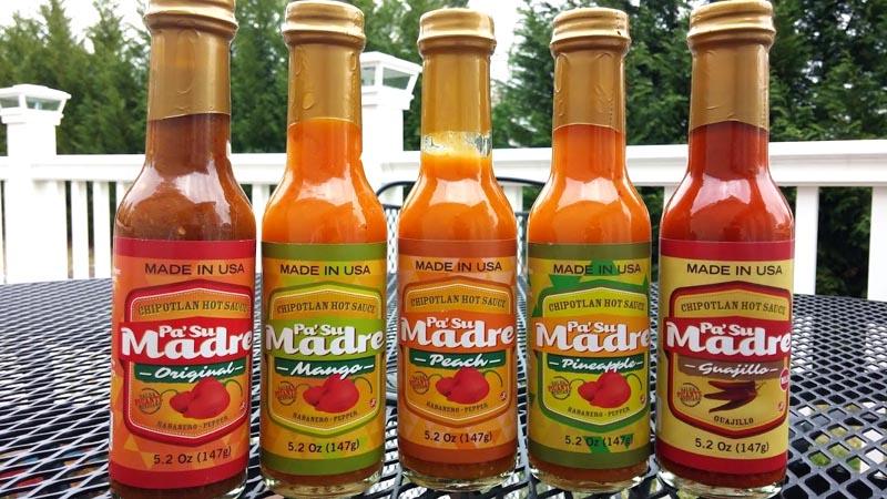 Las botellas de Pa' tu madre de diferentes colores y sabores.