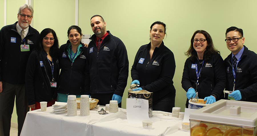 "An ""Ice Cream Social"" hosted by representatives of the Doctors Council and senior members of the hospital's administration and medical staff, including, l. to r.,  COO Wayne Zimmermann, Drs. Isha Mehta and Jasmine Dave, CFO David Guzman, Chief Implementation Officer Jeannith Michelen, Dr. Suzanne Bentley, and Patient Experience Officer Pierre Pham."
