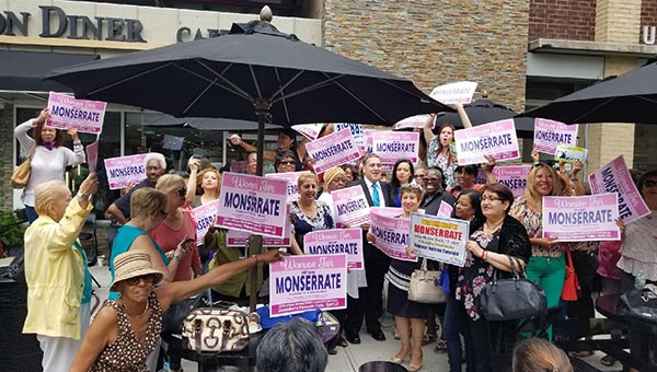 Women From the Community Rally for Hiram Monserrate