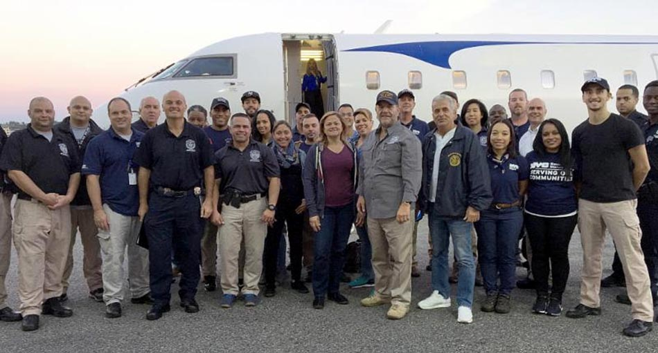 Councilwoman Melissa Mark-Viverito (center) and 22 NYC workers departed to Puerto Rico last weekend.