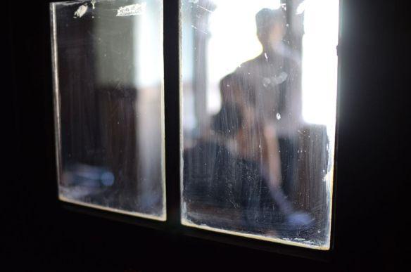 Blurry threesome through a window