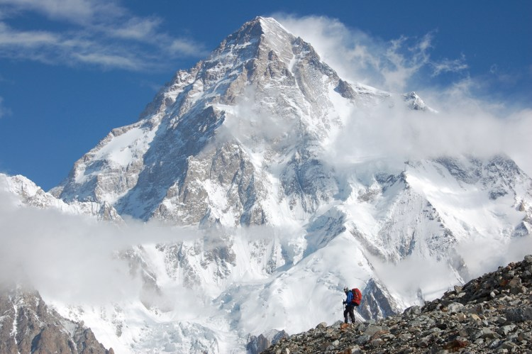 Photo showing climber in front of K2. Photo by Maria Ly.