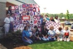 Our Original Nifty Fifty Quilters meeting in 1998 to sew the Breast Cancer Charity Quilts together