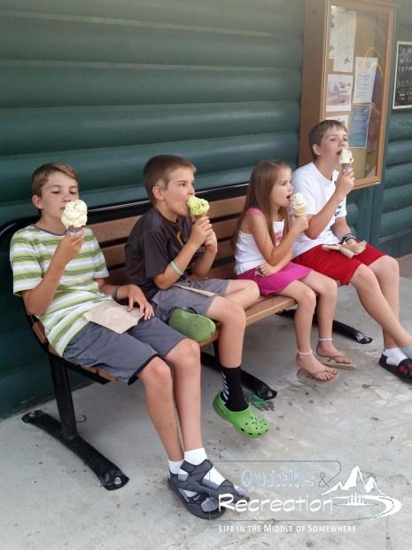four children eating ice cream cones