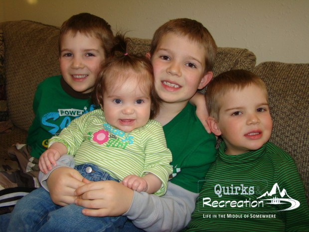 four toddler siblings posing for a photo