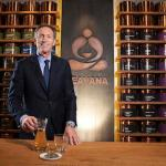 Schultz, chief executive of Starbucks, poses for a portrait at his new Teavana store in New York