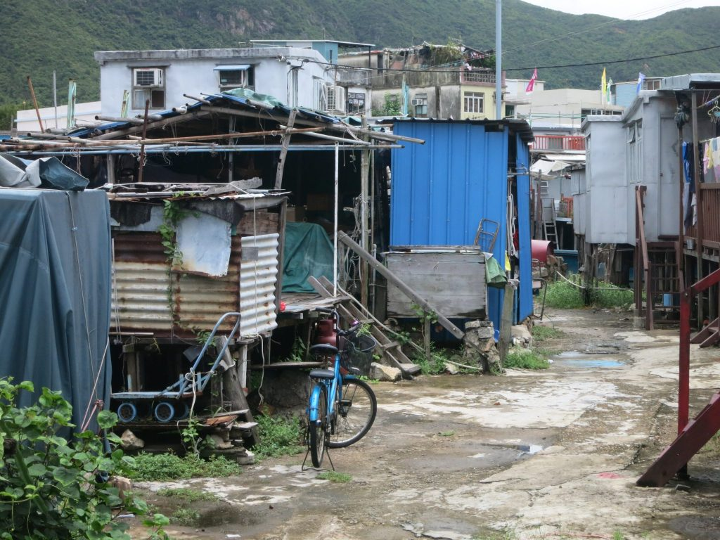 shacks with trash around them in Tai O