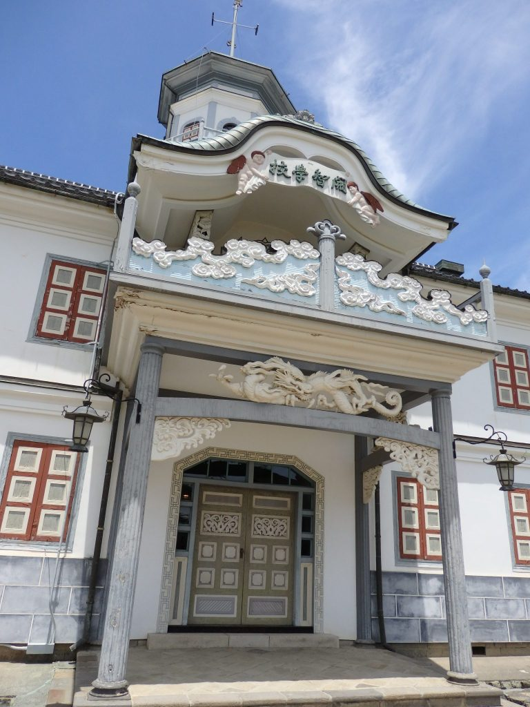 The entrance to the Kaichi School in Matsumoto is in a Victorian style, but the adornments are Japanese, like the dragon above the doorway.