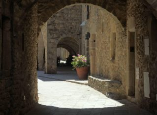 Archways provide shade in Monells,, in the Baix Emporda,, Spain