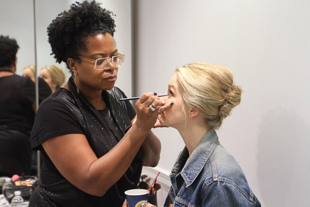Heidi Evora-Santiago of Damali NYC, styles model's makeup behind the scene, backstage at the Dennis Basso 2016 bridal collection fashion show at Kleinfeld, during New York Bridal Fashion Week.