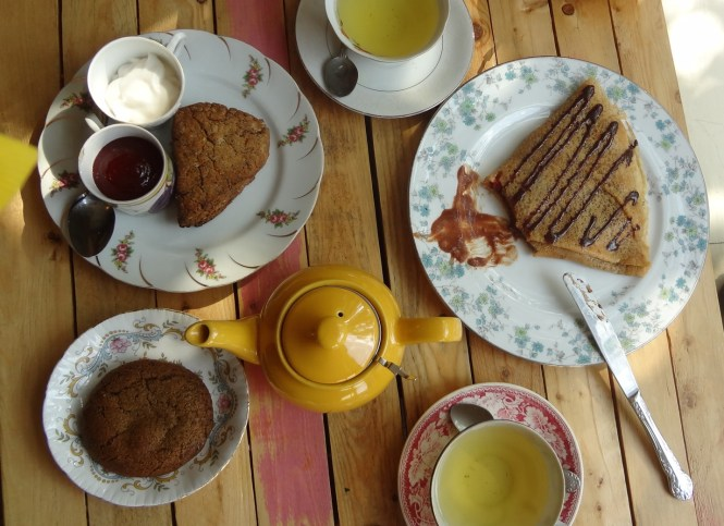 crepes, early gray tea cookie, and lemon poppy scone with jam and coconut clotted cream