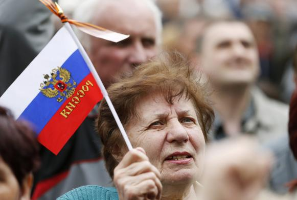 A pro-Russian supporter attends a meeting at the seized office of the SBU state security service in Luhansk