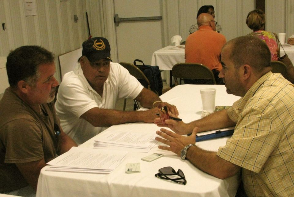NRCS officer Don Barker explains programs to Gene Jacobs, Chief of the Coharie Tribe, and another member of the American Prawn Cooperative.